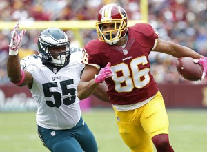 Oct 4, 2015; Landover, MD, USA; Washington Redskins tight end Jordan Reed (86) runs with the ball as Philadelphia Eagles outside linebacker Brandon Graham (55) chases in the first quarter at FedEx Field. The Redskins won 23-20. Mandatory Credit: Geoff Burke-USA TODAY Sports