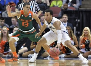 Villanova guard Jalen Brunson (1) looks for help as Miami guard Angel Rodriguez (13) defends during the first half of an NCAA college basketball game in the regional semifinals of the men's NCAA Tournament in Louisville, Ky., Thursday, March 24, 2016. (AP Photo/Timothy D. Easley)