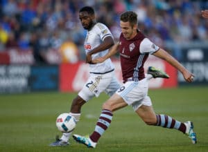 Colorado Rapids forward Kevin Doyle, front, takes a shot as Philadelphia Union defender Warren Creavalle pursues during the first half of an MLS soccer match Saturday, May 28, 2016, in Commerce City, Colo. (AP Photo/David Zalubowski)