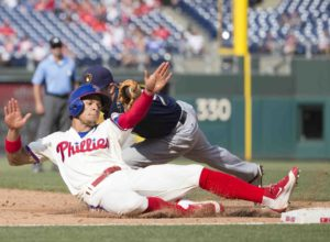 PHILADELPHIA, PA - JUNE 4: Cesar Hernandez #16 of the Philadelphia Phillies slides past Aaron Hill #9 of the Milwaukee Brewers and was ruled safe in the bottom of the sixth inning at Citizens Bank Park on June 4, 2016 in Philadelphia, Pennsylvania. The Brewers defeated the Phillies 6-3. (Photo by Mitchell Leff/Getty Images)