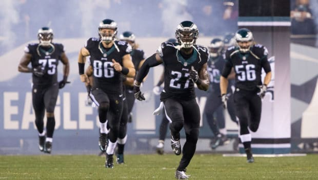 Dec 20, 2015; Philadelphia, PA, USA; Philadelphia Eagles free safety Malcolm Jenkins (27) leads his team onto the field for the start of a game against the Arizona Cardinals at Lincoln Financial Field. The Arizona Cardinals won 40-17. Mandatory Credit: Bill Streicher-USA TODAY Sports