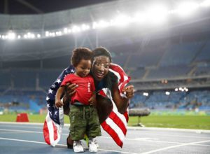 RIO DE JANEIRO, BRAZIL - AUGUST 17:  Nia Ali of the United States celebrates with her son Titus after winning the silver medal in the Women's 100m Hurdles Final on Day 12 of the Rio 2016 Olympic Games at the Olympic Stadium on August 17, 2016 in Rio de Janeiro, Brazil.  (Photo by Cameron Spencer/Getty Images)