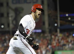 Washington Nationals' Bryce Harper reacts after he hit a three-run home run during the eighth inning of a baseball game against the Philadelphia Phillies, Saturday, Sept. 10, 2016, in Washington. The Nationals won 3-0. (AP Photo/Nick Wass)
