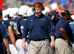 TAMPA, FL - JANUARY 01:  Assistant coach Mike McQueary of the Penn State Nittany Lions walks along the sideline against the Florida Gators during the Outback Bowl at Raymond James Stadium on January 1, 2011 in Tampa, Florida.  (Photo by J. Meric/Getty Images)