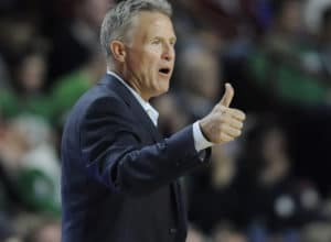 Philadelphia 76ers head coach Brett Brown gestures to his team during the second half of an NBA preseason basketball game against the Boston Celtics, Tuesday, Oct. 4, 2016, in Amherst, Mass. (AP Photo/Jessica Hill)