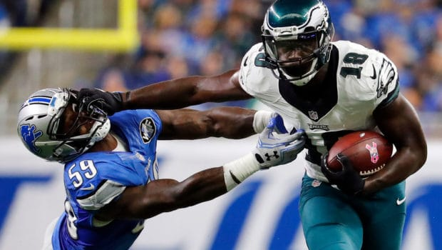 Philadelphia Eagles wide receiver Dorial Green-Beckham (18) stiff-arms Detroit Lions outside linebacker Steve Longa (59) during the second half of an NFL football game, Sunday, Oct. 9, 2016, in Detroit. (AP Photo/Rick Osentoski)