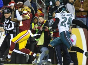 Dec 20, 2014; Landover, MD, USA; Washington Redskins wide receiver DeSean Jackson (11) makes a reception as Philadelphia Eagles cornerback Bradley Fletcher (24) defends during the second half at FedEx Field. The Redskins won 27-24. Mandatory Credit: Brad Mills-USA TODAY Sports