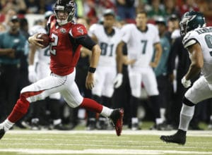 Sep 14, 2015; Atlanta, GA, USA; Atlanta Falcons quarterback Matt Ryan (2) runs with the ball past Philadelphia Eagles inside linebacker Mychal Kendricks (95) in the second quarter at the Georgia Dome. Mandatory Credit: Brett Davis-USA TODAY Sports