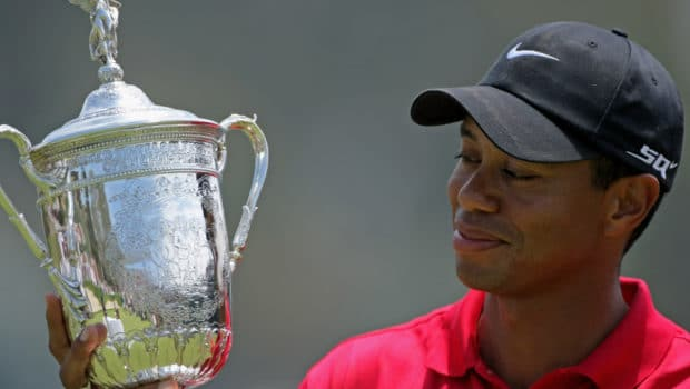 SAN DIEGO - JUNE 16:  Tiger Woods celebrates with the trophy after winning on the first sudden death playoff hole during the playoff round of the 108th U.S. Open at the Torrey Pines Golf Course (South Course) on June 16, 2008 in San Diego, California.  (Photo by Doug Pensinger/Getty Images) ORG XMIT: 81585729 GTY ID: 85729TL108_U_S_Open_Cham