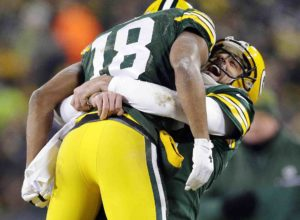 Jan 8, 2017; Green Bay, WI, USA; Green Bay Packers wide receiver Randall Cobb (18) celebrates with quarterback Aaron Rodgers (12) after scoring a touchdown on a hail mary in the 2nd quarter in the NFC Wild Card playoff football game at Lambeau Field. Mandatory Credit: Rick Wood/Milwaukee Journal Sentinel via USA TODAY Sports