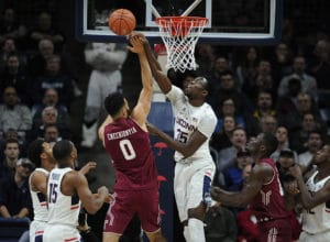 Connecticut's Amida Brimah blocks a shot by Temple's Obi Enechionyia, left, in the first half of an NCAA college basketball game, Wednesday, Jan. 11, 2017, in Storrs, Conn. (AP Photo/Jessica Hill)