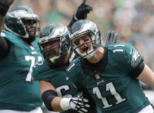 Eagles' quarterback Carson Wentz celebrates his first NFL passing touchdown with teammates center Jason Kelce and tackle Jason Peters against the Cleveland Browns on Sunday, September 11, 2016.  YONG KIM / Staff Photographer