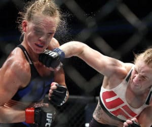 Valentina Shevchenko, right, of Kyrgyzstan, punches Holly Holm during a women's bantamweight mixed martial arts bout in Chicago, Saturday, July 23, 2016. (AP Photo/Nam Y. Huh) ORG XMIT: ILNH139