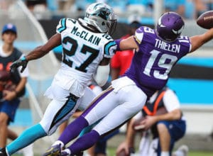 Sep 25, 2016; Charlotte, NC, USA; Minnesota Vikings wide receiver Adam Thielen (19) makes a one handed catch over Carolina Panthers defensive back Robert McClain (27) during the second half at Bank of America Stadium. Mandatory Credit: Jim Dedmon-USA TODAY Sports