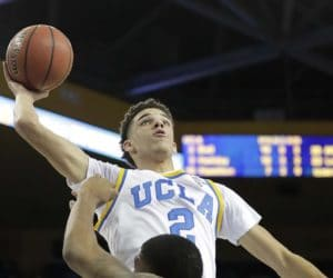 UCLA's Lonzo Ball, top, goes up for a dunk over Pacific's D.J. Ursery during the first half of an NCAA college basketball game Friday, Nov. 11, 2016, in Los Angeles. (AP Photo/Jae C. Hong) ORG XMIT: CAJH104