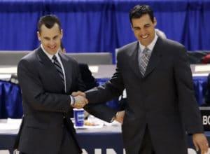 University of Florida's head coach Billy Donovan, left, shakes hands with Villanova's head coach Jay Wright before the start of their NCAA Regional final basketball game in Minneapolis, Sunday, March 26, 2006. (AP Photo/Ann Heisenfelt)