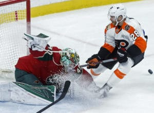 Minnesota Wild goalie Devan Dubnyk, left, stops a shot by Philadelphia Flyers' Claude Giroux during the second period of an NHL hockey game Thursday, March 23, 2017, in St. Paul, Minn. (AP Photo/Jim Mone)