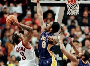 PHILADELPHIA, :  The Philadelphia 76ers Allen Iverson (L) tries to shoot over the Los Angeles Lakers Kobe Bryant (R) during their game 20 February, 2000, at the  First Union Center in Philadelphia. At right is the Lakers Rick Fox. The lakers won 87-84.   AFP PHOTO/Tom Mihalek (Photo credit should read TOM MIHALEK/AFP/Getty Images)